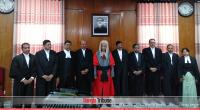 Nine additional justices take oath