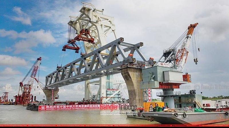 Padma Bridge becomes visible with the installation of the first span at the Jajira point in Shariatpur