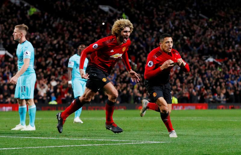 Football - Premier League - Manchester United v Newcastle United - Old Trafford, Manchester, Britain - October 6, 2018  Manchester United's Alexis Sanchez celebrates scoring their third goal with Marouane Fellaini   REUTERS
