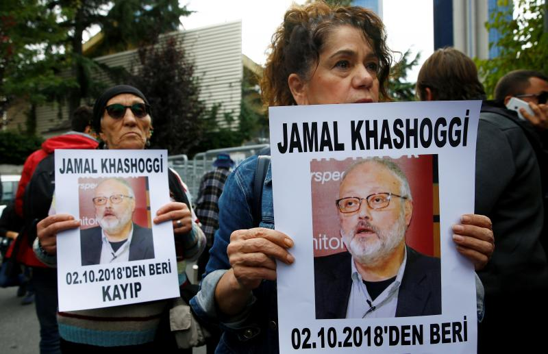 Human rights activists hold pictures of Saudi journalist Jamal Khashoggi during a protest outside the Saudi Consulate in Istanbul, Turkey October 9, 2018. REUTERS