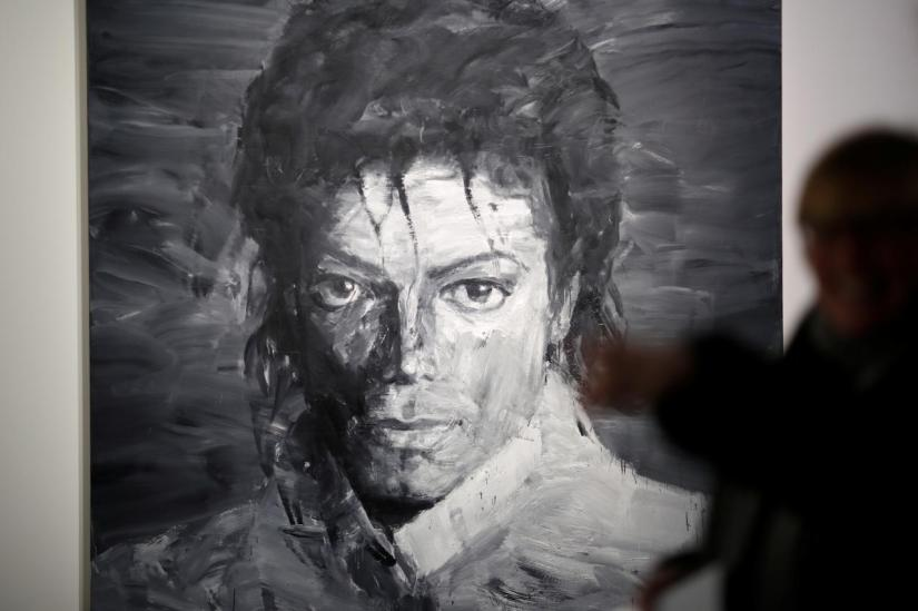 A visitor views `In Memory of Michael Jackson 1958-2009` by Yan Pei-Ming which forms part of the exhibition `Michael Jackson: On The Wall` showing until October 21 at the National Portrait Gallery in London, Britain, June 28, 2018. REUTERS