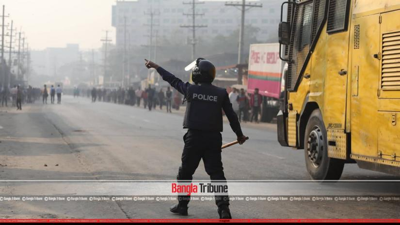 Police dispersed garment workers, who came out from the factories and blockaded the Baipail-Abdullahpur road on Monday (Jan 14)