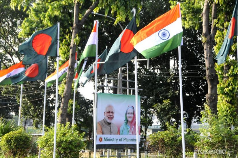 Photo taken on June 5, 2015 shows billboards of Indian Prime Minister Narendra Modi and Bangladeshi Prime Minister Sheikh Hasina in Dhaka, Bangladesh. File Photo