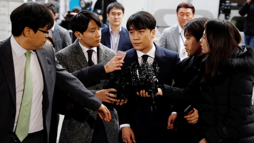 Seungri, a member of South Korean K-pop band Big Bang, arrives to be questioned over a sex bribery case at the Seoul Metropolitan Police Agency in Seoul, South Korea, March 14, 2019. REUTERS
