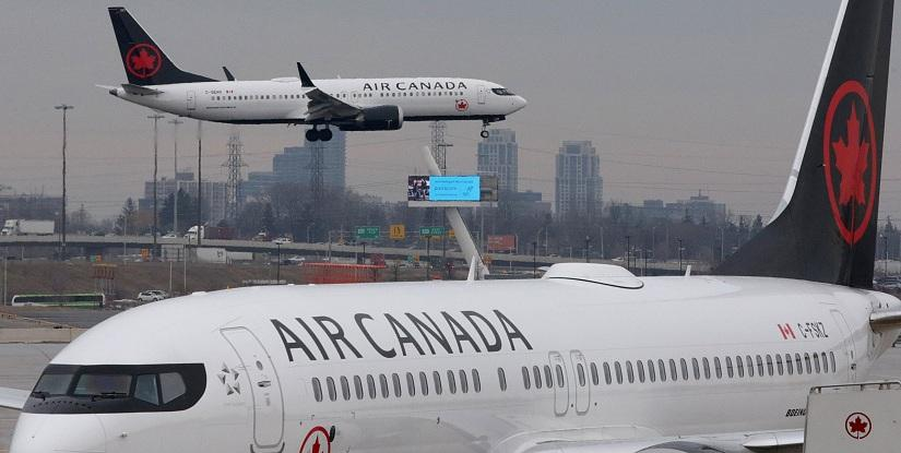 An Air Canada Boeing 737 MAX 8 from San Francisco approaches for landing at Toronto Pearson International Airport over a parked Air Canada Boeing 737 MAX 8 aircraft in Toronto, Ontario, Canada, March 13, 2019. REUTERS