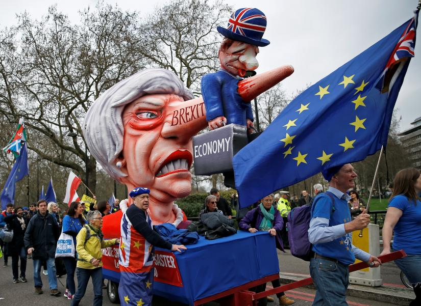 BRITAIN-EU-MARCHEU supporters, calling on the government to give Britons a vote on the final Brexit deal, lead a cart with an effigy of Britain`s Prime Minister Theresa May as they participate in the `People`s Vote` march in central London, Britain March 23, 2019. REUTERS