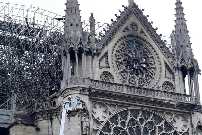 Firefighters work at Notre-Dame Cathedral in Paris, France April 16, 2019. A massive fire consumed the cathedral on Monday, gutting its roof and stunning France and the world. REUTERS