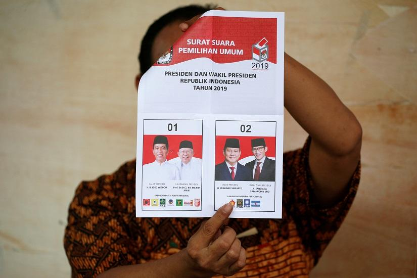 A person holds up a voting ballot during the counting of the Indonesian elections results in Jakarta, Indonesia April 17, 2019. REUTERS