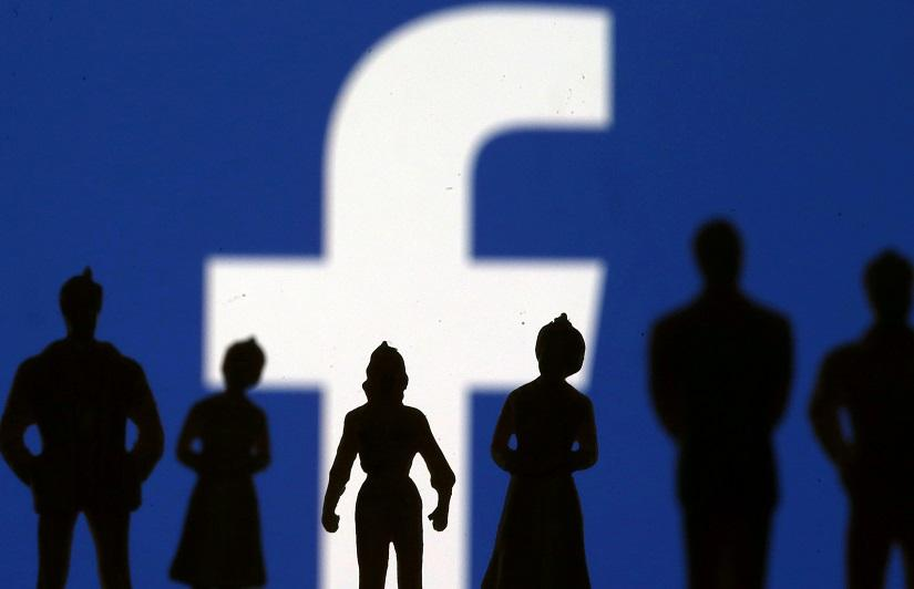 Small toy figures are seen in front of Facebook logo in this illustration picture, Apr 8, 2019. REUTERS/File Photo
