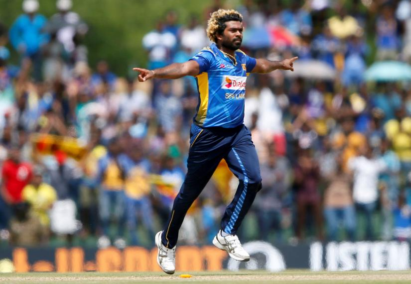 Sri Lanka`s Lasith Malinga celebrates after taking the wicket of England`s Liam Dawson (not pictured)