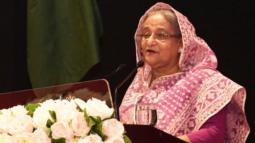 Prime Minister Sheikh Hasina addresses a mass reception accorded to her by Bangladesh community living in Brunei's capital Brunei Darussalam at the Indera Samudera Ballroom of the Empire Hotel and County Club on Sunday (Apr 21). PID