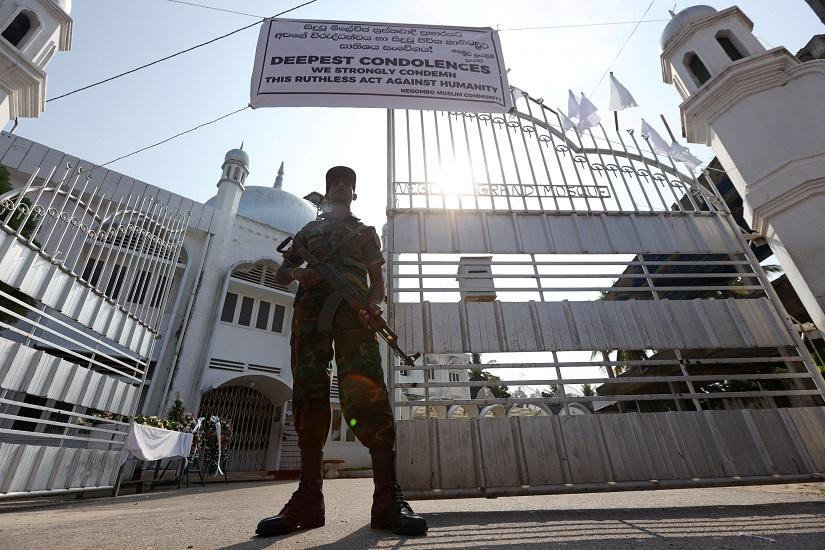 A member of the Civil Defence Force keeps watch outside Negombo Grand Mosque, following a string of suicide attacks on churches and luxury hotels, in Negombo, Sri Lanka, April 25, 2019. REUTERS
