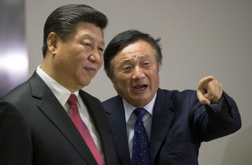 Chinese President Xi Jinping (left) is shown around the offices of Huawei in London by company founder Ren Zhengfei in 2015. Ren has rejected allegations that Huawei would engage in espionage on behalf of the Chinese government. REUTERS
