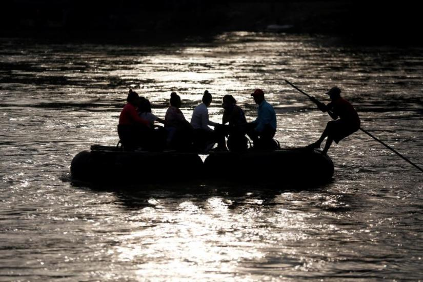 Migrants cross the Suchiate river on a raft from Tecun Uman, in Guatemala, to Ciudad Hidalgo, as seen from Ciudad Hidalgo, Mexico, June 13, 2019. REUTERS