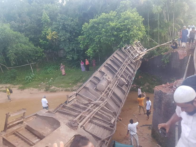 Photo shows one of the derailed bogies of Upaban Express train at Baramchal in Moulvibazar's Kulaura upazila during a rescue operation in the early hours of Monday, June 24, 2019 Dhaka Tribune