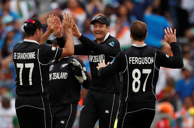 Cricket - ICC Cricket World Cup Semi Final - India v New Zealand - Old Trafford, Manchester, Britain - July 10, 2019 New Zealand`s Martin Guptill celebrates with team mates after taking the wicket of India`s MS Dhoni Action Images via Reuters