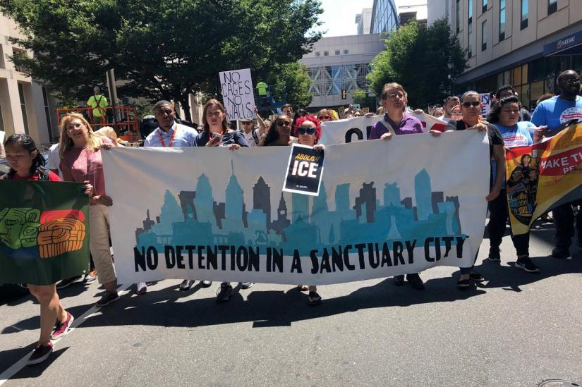 Activists, many from the Netsroot Nation conference, protest President Donald Trump's immigration policy as they march in Philadelphia, Pennsylvania, US, July 12, 2019. REUTERS