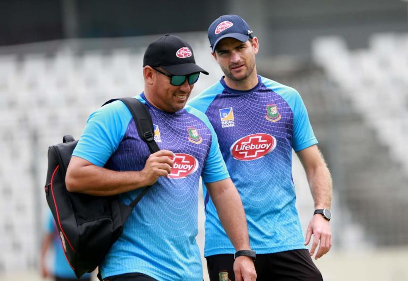 Bangladesh`s head coach Russell Domingo (L), and fielding consultant Ryan Cook