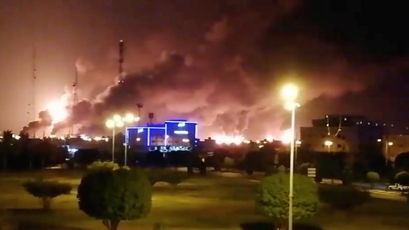 Smoke is seen following a fire at an Aramco factory in Abqaiq, Saudi Arabia, September 14, 2019 in this picture obtained from social media. Reuters