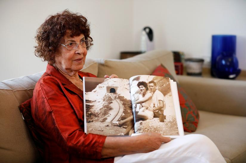 Nadia, widow of Israeli spy Eli Cohen, shows a photograph of herself with her late husband, during an interview with Reuters in Herzliya, Israel October 6, 2019. Picture taken October 6, 2019. REUTERS