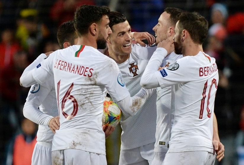 Soccer Football - Euro 2020 Qualifier - Group B - Luxembourg v Portugal - Stade Josy Barthel, Luxembourg City, Luxembourg - November 17, 2019 Portugal`s Cristiano Ronaldo celebrates scoring their second goal with team mates REUTERS
