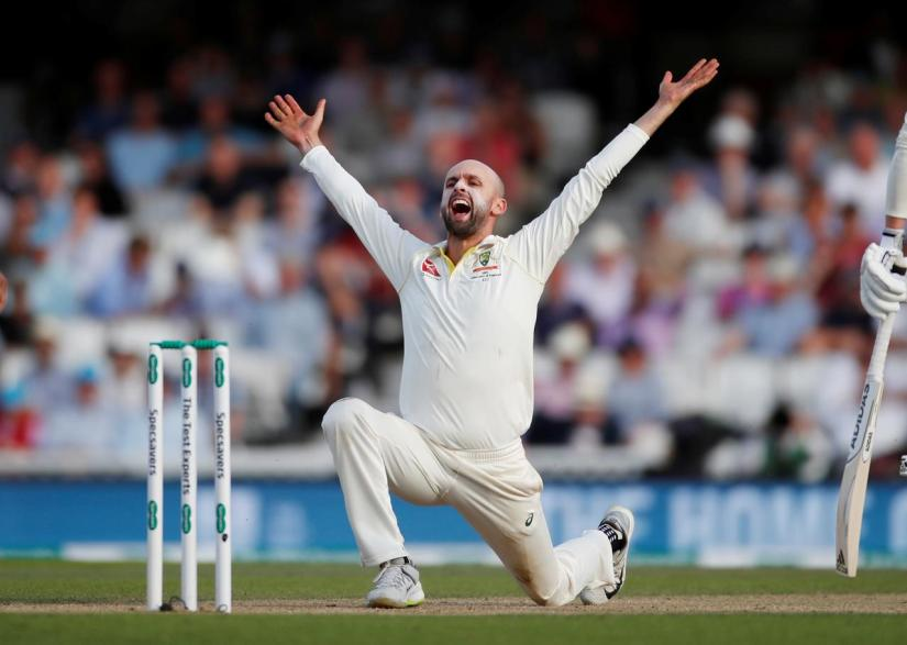 FILE PHOTO: Cricket - Ashes 2019 - Fifth Test - England v Australia - Kia Oval, London, Britain - September 14, 2019 Australia`s Nathan Lyon appeals the wicket of England`s Jos Buttler Action Images via Reuters