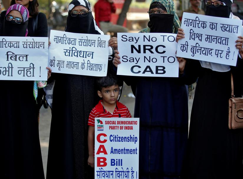 Demonstrators display placards during a protest against the Citizenship Amendment Bill, a bill that seeks to give citizenship to religious minorities persecuted in neighbouring Muslim countries, in Ahmedabad, India, December 9, 2019. REUTERS