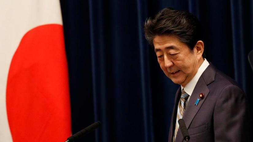 FILE PHOTO: Japan`s Prime Minister Shinzo Abe attends a news conference in Tokyo, Japan, Dec 9, 2019. REUTERS