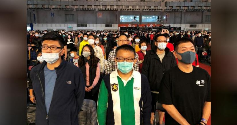 Foxconn employees wearing masks attend the company`s year-end gala in Taipei, Taiwan January 22, 2020. REUTERS