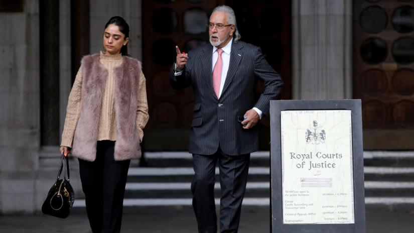 Indian businessman Vijay Mallya and his partner Pinky Lalwani leave the Royal Courts of Justice in London, Britain Feb 11, 2020. REUTERS