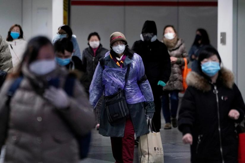 People wearing face masks walk inside a subway station, as the country is hit by an outbreak of the novel coronavirus, in Shanghai, China Feb 17, 2020. REUTERS