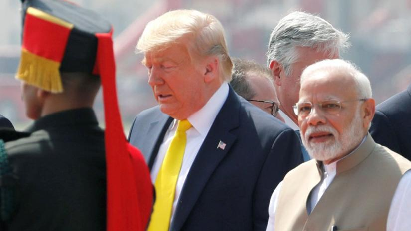 US President Donald Trump is welcomed by Indian Prime Minister Narendra Modi as he arrives at Sardar Vallabhbhai Patel International Airport in Ahmedabad, India Feb 24, 2020. REUTERS