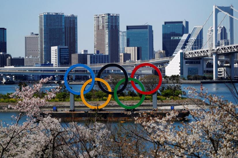FILE PHOTO: Giant Olympic rings seen at the waterfront area at Odaiba Marine Park in Tokyo, Japan, Mar 25, 2020, after the announcement of the Games` postponement to 2021, due to outbreak of coronavirus disease (COVID-19). REUTERS